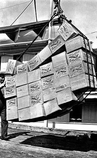 Petersburg, Alaska - Loading boxes of salmon in Petersburg in 1915.