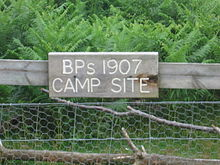 "wooden sign on a fence, reading ""BP's 1907 CAMP SITE"""