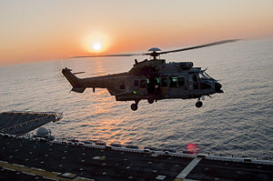 Eurocopter EC725 - A Brazilian EC725 preparing to land on the flight deck of amphibious assault ship USS ''America'', 2014