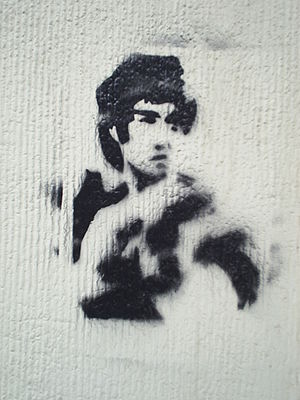 The image of Bruce Lee on the wall