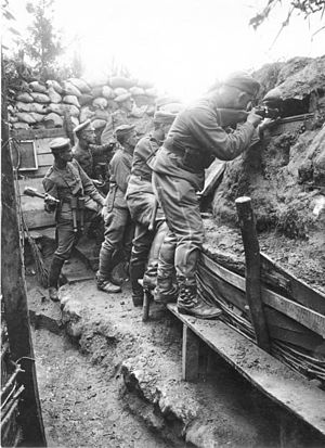 Trench warfare - German soldiers of the 11th Reserve Hussar Regiment fighting from a trench, on the Western Front, 1916