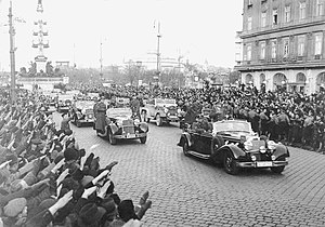 SS-Begleitkommando des Führers - Hitler's motorcade with FBK and RSD escort cars to the left and right behind his car, as they head towards the city center of Vienna in 1938