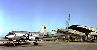 Interflug - An Ilyushin Il-14 of Interflug at Schönefeld Airport in 1961, a time when the terminal building was under construction.