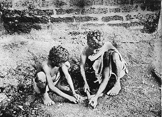 Paniya people - Paniyas making fire (1909).