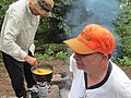 Campers cooking macaroni and cheese.jpg