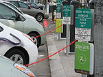 Several plug-in electric vehicles recharging at San Francisco City Hall public charging station.