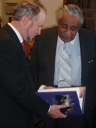 Charles Rangel - Rangel receives book written by US Consul General Gregory Slayton, in Bermuda in 2009