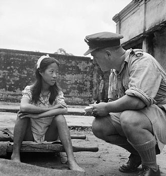 "Comfort women - Rangoon, Burma. August 8, 1945. A young ethnic Chinese woman from one of the Imperial Japanese Army's ""comfort battalions"" is interviewed by an Allied officer."