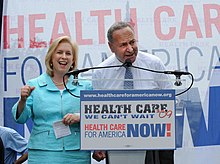 Kirsten Gillibrand and Chuck Schumer are seen giving a speech promoting universal healthcare.