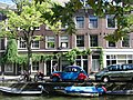 Citroën 2CV next to canal in Amsterdam 2009.jpg