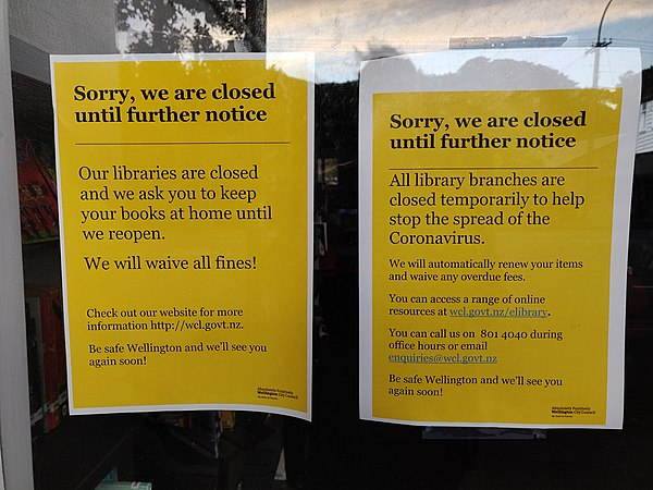 Announcement posted in the door of a public library in Island Bay, New Zealand that it is closed due to the pandemic, and will waive all late return fees. Closed library - Island Bay.jpg