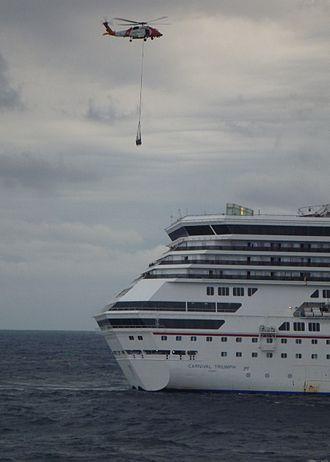 Carnival Triumph - Image: Coast Guard helicopter crew delivers supplies to Cruise Ship Triumph