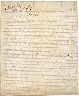 "Light-brown parchment with ""We the people"" in large black cursive"