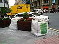 Construction rubble bags and planters on the corner (18187240303).jpg