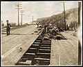 Construction workers on plank road during Alki Avenue regrade, April 19, 1913 (MOHAI 6134).jpg
