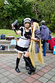 Cosplayer of Bishamonten with other one Watching Mobile Phone 20150228.jpg