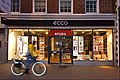Cycling past Ecco Shoes, High St., SUTTON, Surrey, Greater London.jpg