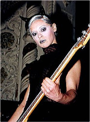 D'arcy Wretzky - Wretzky playing bass guitar with the Smashing Pumpkins during the Adore era (circa April 1998).