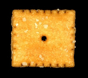A Cheez-It cracker, shown near actual size on ...