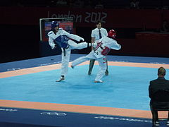 Davin Sorn vs María Espinoza at the 2012 Olympic games.jpg
