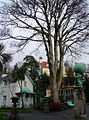 December courtyard with leafless tree and statue of Atlas carrying the world (Portmeirion 2004).jpg