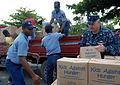 Defense.gov News Photo 100920-N-4971L-095 - U.S. Navy Lt. Cmdr. Ken Cremeans right deputy mission commander for Southern Partnership Station 2010 helps members of the Dominican Republic s.jpg