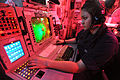Defense.gov News Photo 110426-N-0569K-005 - Seaman Nathalie G. Sanchez operates an advanced combat direction system console in the commanding officer s tactical plot room aboard the aircraft.jpg
