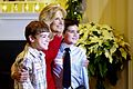 Dr. Jill Biden poses for a picture with two of 50 children she invited to a holiday event at their home, 2010.jpg