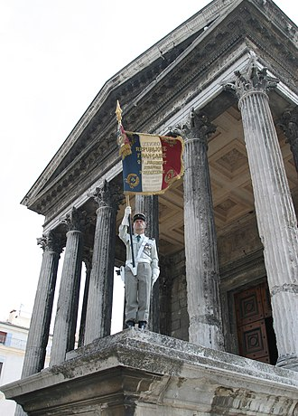 2nd Foreign Infantry Regiment - Regimental Colors of the 2ème Étranger on the best preserved Roman temple, the Maison Carrée.