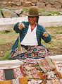 Drop spinning female on a market Peru.jpg