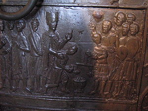 History of Poland during the Piast dynasty - An image on the Gniezno Doors at the entrance to Gniezno Cathedral depicts Bolesław buying Adalbert's body back from the Prussians
