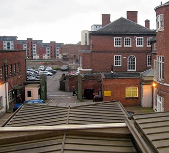 Greyfriars, Leicester - The museum roof in the foreground follows the walls of the Greyfriars Church, covering Richard III's grave site at the far end. The nave of the Church continued west across New Street and some distance into the next car park.