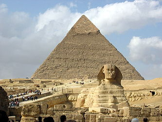 The Great Sphinx of Giza against Khafre's Pyramid at the Giza pyramid complex.
