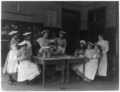Eight girls and teacher in a cooking class in a Washington, D.C., high school.png