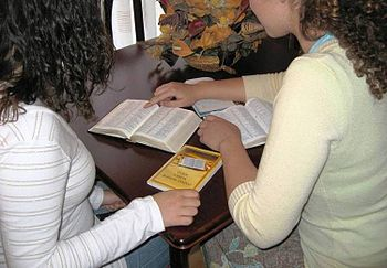 English: Home bible study with the help of a b...