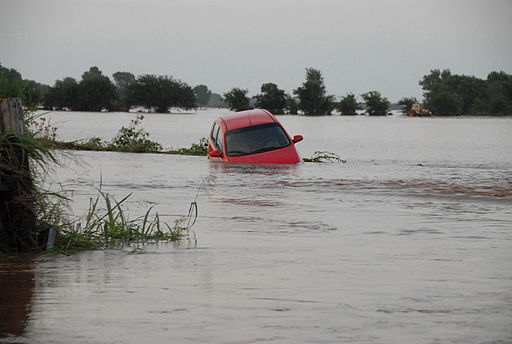 FEMA - 32048 - Red car floating in flood waters in Oklahoma