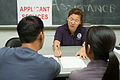 FEMA - 32768 - FEMA Applicant Assistance worker helps residents in New York.jpg