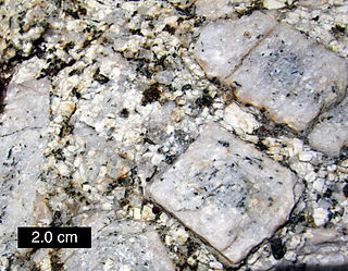 Matrix (geology) Finer-grained material in a rock within which coarser material is embedded