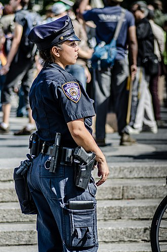 Women in law enforcement in the United States - Female NYPD officer monitoring a crowd in Union Square.