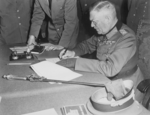 Field Marshall Wilhelm Keitel, signing the ratified surrender terms for the German Army at Russian Headquarters in... - NARA - 531290.png