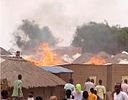 Fire in Parabongo IDP camp, Uganda crop.jpg