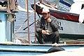 Fisherman in Harbour - Kalekoy - Gokceada Island - Turkey (5740543949).jpg