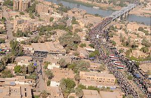 Al-Sarafiya bridge - Image: Flickr DVIDSHUB Pilgrims Cross Over New Bridge in Iraq