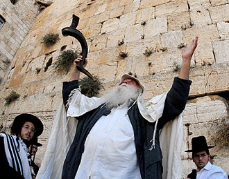 "Shofar - Jewish ""Slichot"" prayer service with shofar during the Days of Repentance preceding Yom Kippur at the Western Wall in Jerusalem's Old City, 2008."