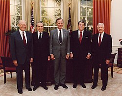 (Left to right:) Former Presidents Gerald Ford, Richard Nixon, then President George H. W. Bush, and former Presidents Ronald Reagan and Jimmy Carter at the dedication of the Reagan Presidential Library (1991).