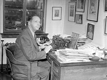 Foster Hewitt sitting at his office desk.