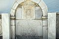 Fountain at the church in Menites, Andros. Marble relief, 090628.jpg