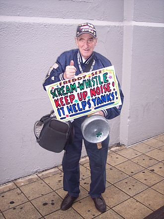 Freddy Schuman - Freddy holding one of his signs near the Bleachers entrance to Yankee Stadium