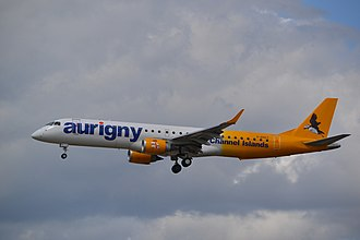 Aurigny - Aurigny's Embraer 195 on final approach to Gatwick in May 2015