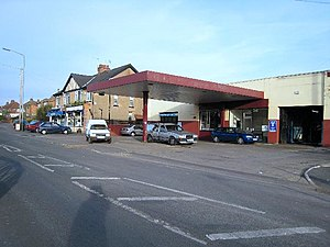 English: Garage and shops in Lillington The ga...